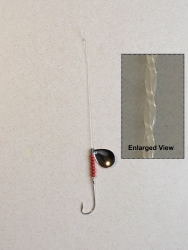 Straightened Mono Fishing Leader with hook, spinner and red beads